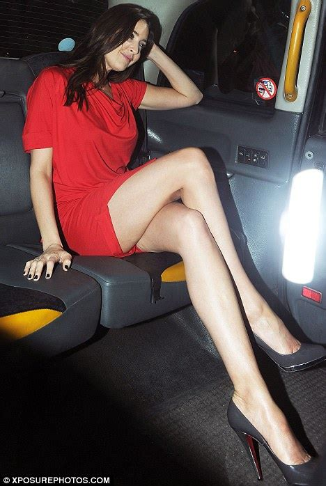 Lisa Snowdon shows off her incredibly long legs in a red