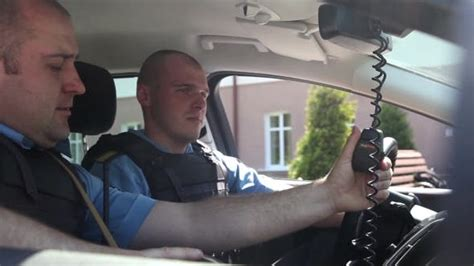 Two Police in the Car Talking on the Radio by studiodav