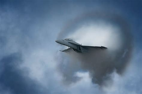 Stunning photos show jet fighter creating sonic boom as it